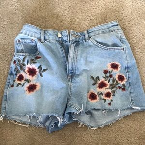 Denim shorts with floral pattern